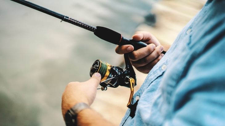 Close up of man holding fishing rod